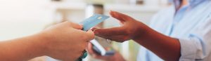 A person paying with a credit card